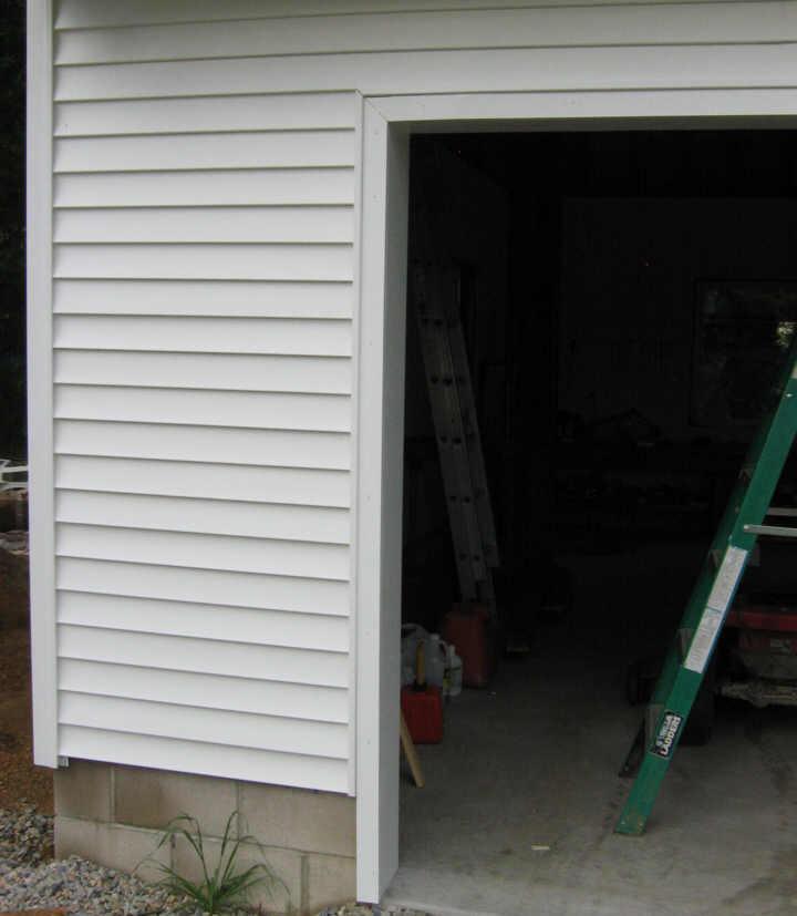 door siding cedar shakes above garage door wooden