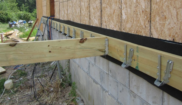 At The End Of The Day We Tacked Up Joist Hangers On The East Side, 16  Inches On Center: