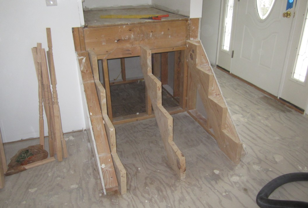 cut the bottom of the wall to allow for the newel posts